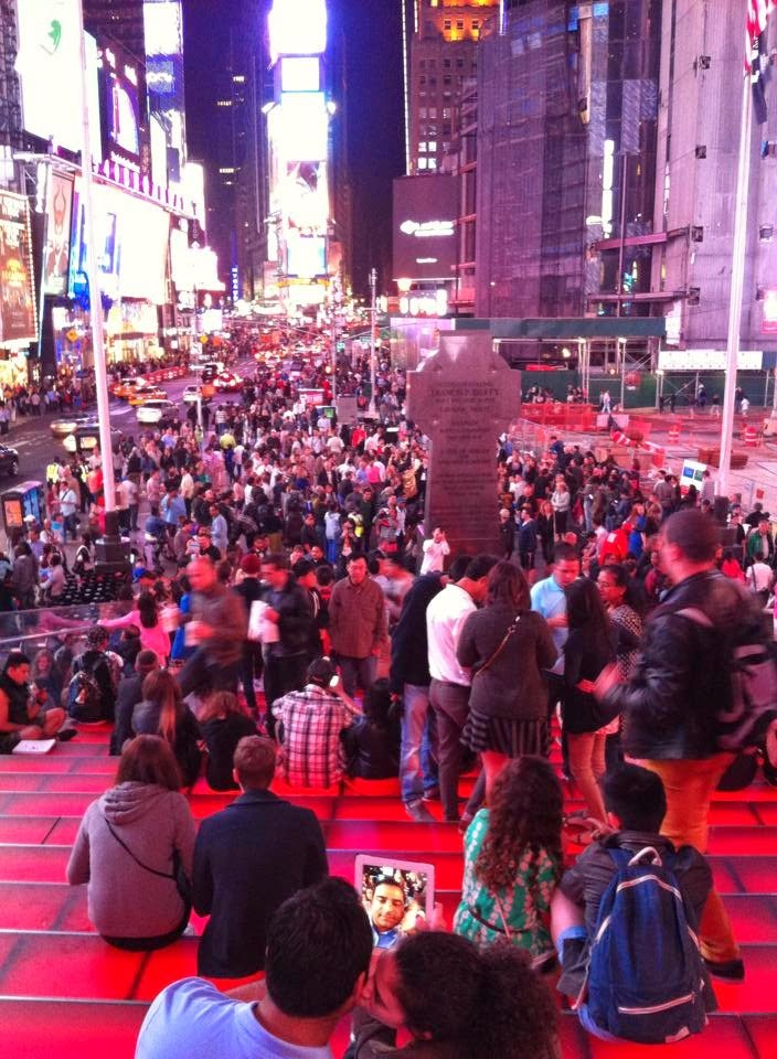 Times Square, tourists, red steps